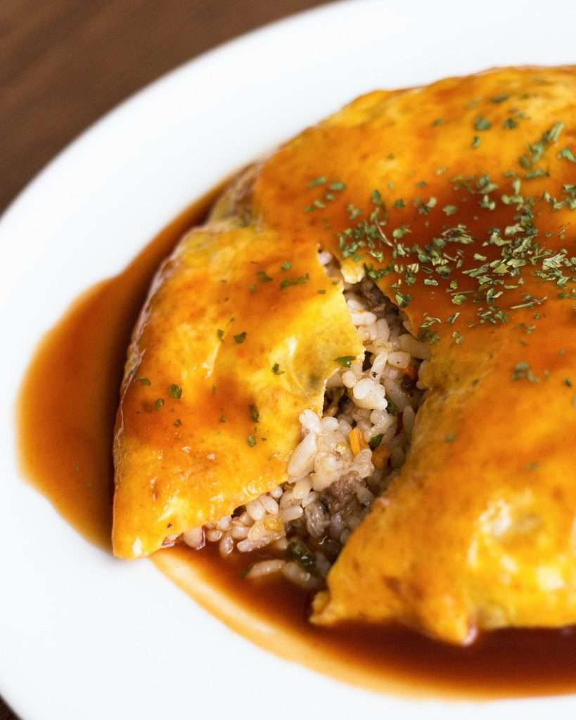 close-up of beef fried rice in an omelette