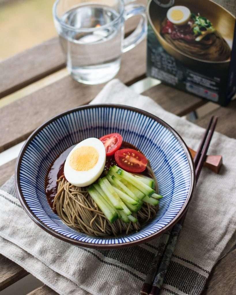 bibim makguksu korean cold noodles served in a bowl